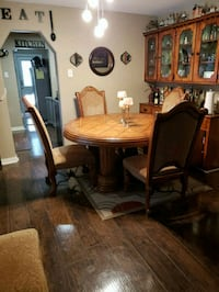 round brown wooden table with four chairs dining set Houston, 77093