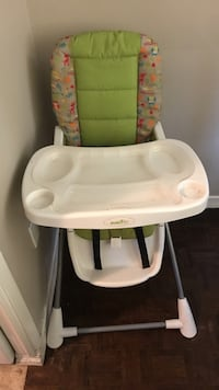 Baby's white and green high chair