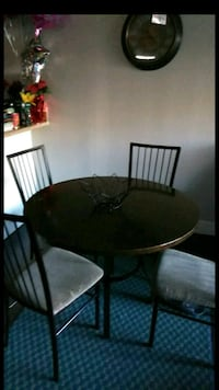 round brown wooden table with four chairs  Hayward, 94544