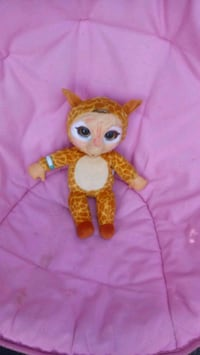 brown and white  plush toy