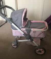 Toy pink and gray bassinet stroller