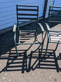 3 Green patio chairs