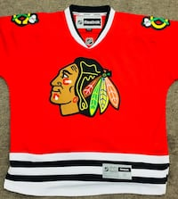 red and white Chicago Blackhawks Reebok v-neck jersey shirt