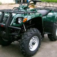 black and green Kawasaki ATV Conway, 72034