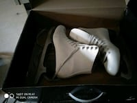 pair of white-and-black skating shoes  Vaughan, L6A 0T2