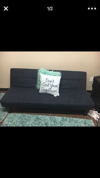 black fabric sofa with throw pillows