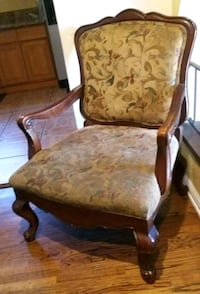 brown wooden framed brown padded armchair