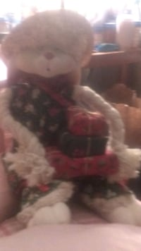 A Christmas bunny with a porcelain face and .ears and dress   for  a p