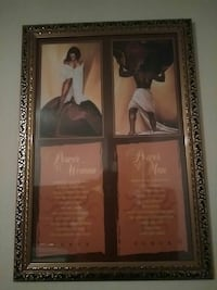 two power of woman and man paintings with brown wooden frames Columbia, 29210