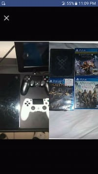 black Sony PS4 console with controller and game cases Tampa, 33612