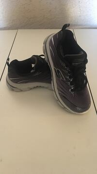 pair of black-and-grey Skechers running shoes
