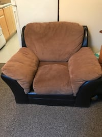 Brown and black fabric sofa chair. Well loved. Still has lots of life left. Bottom got ripped out while moving. And the legs are missing. You pick up Eugene, 97401