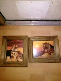 two brown wooden framed paintings 2055 mi