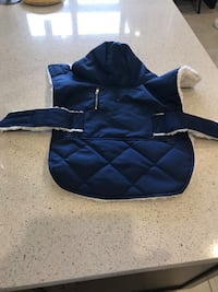 Small dog coat never used. Regina, S4W 0A9