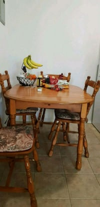 oval brown wooden table with six chairs dining set Montréal, H1G 2M8
