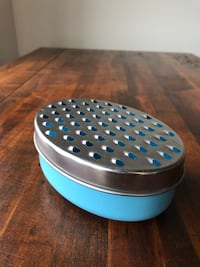 Cheese grater w/ container