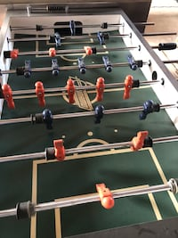 brown and green foosball table Rocky View No. 44, T0M 0P6