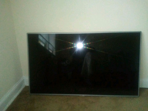 55 inch LG TV with wall mount and fire stick