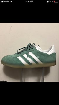 green and white Adidas low-top sneakers