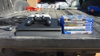 black Sony PS4 console with controllers and game cases Moriarty, 87035
