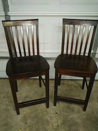 two brown wooden chairs with black leather pads Pharr, 78577
