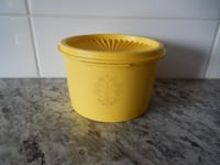 """*Vintage* Yellow Tupperware Container. Small sized, measures 3"""" x 5"""" and is #1297-11 $5 PU Morinville Morinville"""
