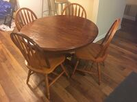 oval brown wooden table with four chairs dining set Atlanta, 30329