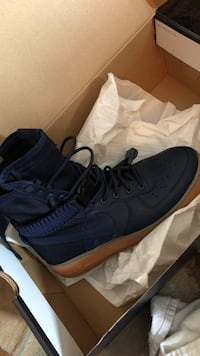 blue and brown Nike Air Force 1 shoe with box