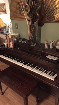 black, white, and brown upright piano Peabody, 01960