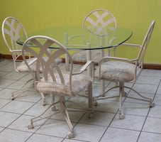Glass top kitchen table and four chairs with casters