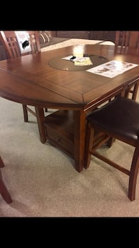 Brown wooden table and chairs set 1076 mi
