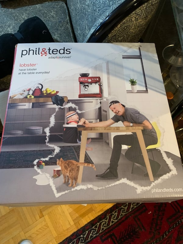 Phil n teds high chair ( attachable to your counter top or table ) 6af9cc3a-a0c4-4db0-a904-072a3a9ae9e5