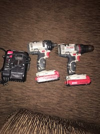 two black and red cordless power tools
