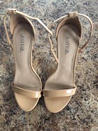 Pair of beige leather open toe ankle strap heels. Size 6 Minto, N0G 1M0