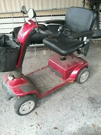 red and black mobility scooter Umatilla, 32784