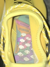 Yellow human races by Pharrell Williams Annandale, 22003