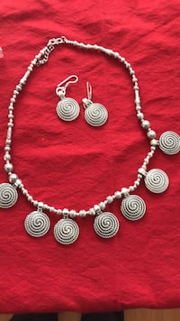 silver and gold necklace and earrings null