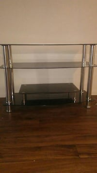stainless steel framed glass top table