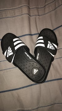 Size 10 black and white adidas flip flops  Calgary, T3H 0R9