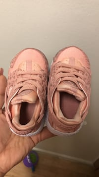pair of toddler's pink Nike Air Huarache shoes