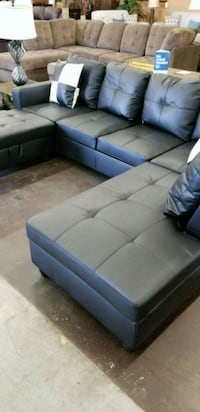 Contemporary black sectional with an ottoman
