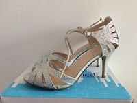 pair of silver-colored open-toe heels Mississauga