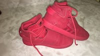 Pair of red adidas high-top sneakers Mississauga, L5B 4B4