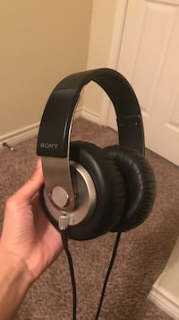 black and gray Sony wired headphones