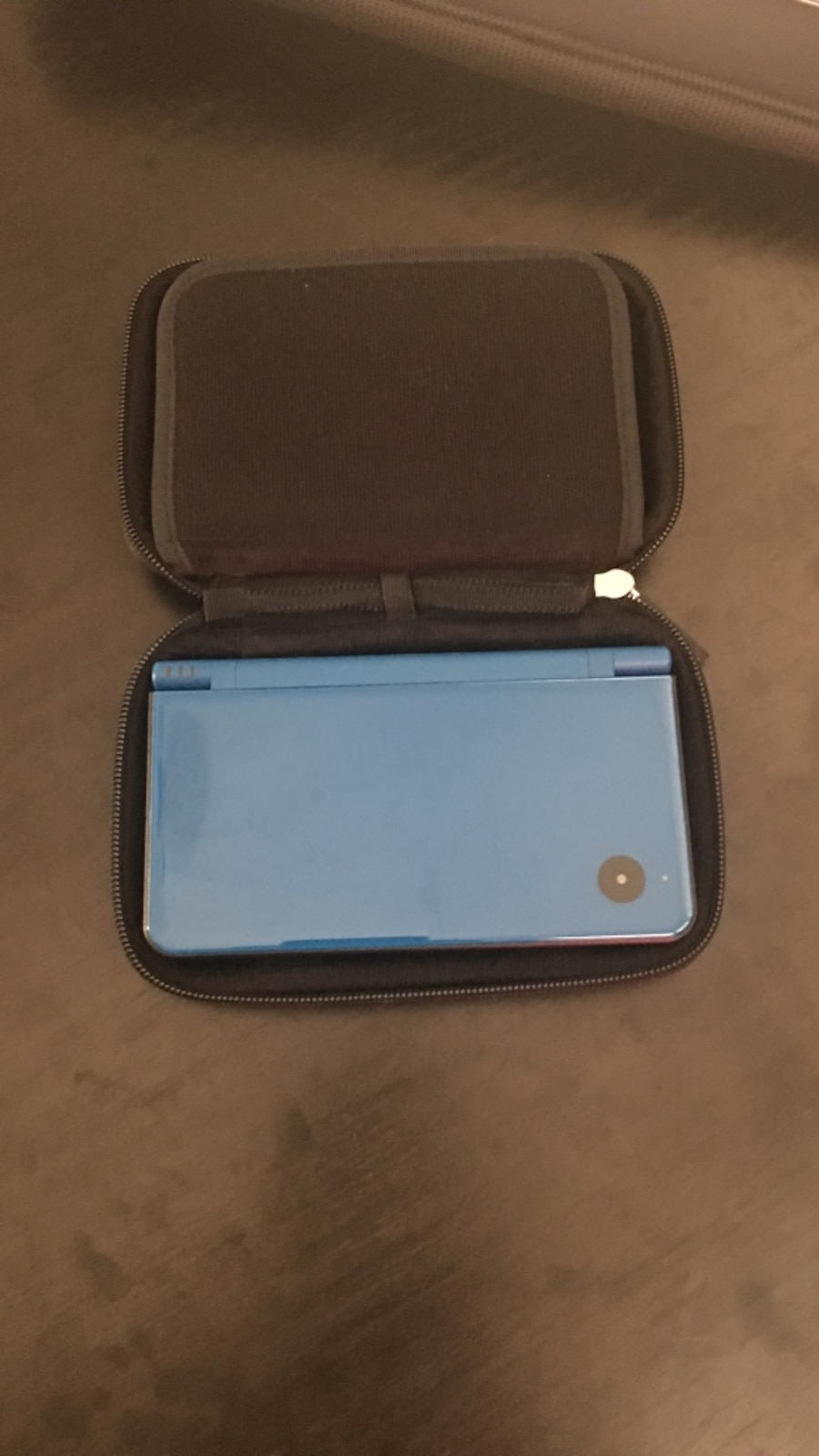 Nintendo DS XL includes 8 games, charger and carry case - good condition