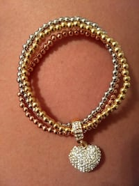 silver and gold-colored charm bangles