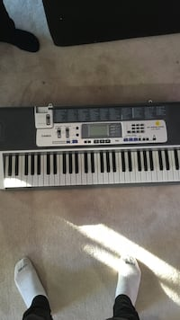black and gray Casio electric keyboard Bel Air, 21014