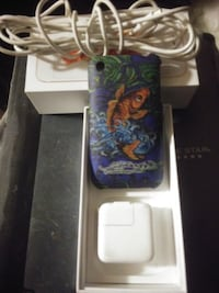 I Phone 4 with Ed Hardy Cover, Apple Charging Block and a white cord Victoria