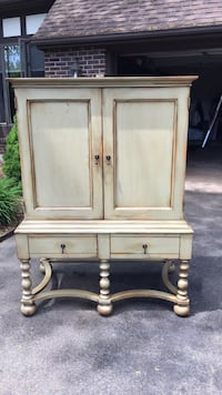 Greenish washed solid wood cabinet. Two shelves and drawers. Made in the USA Middletown, 06457