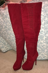 Red thigh-high studded platform stiletto boots